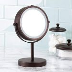 mDesign miroir lumineux à LED – miroir à maquillage avec grossissement x7 – miroir make-up inclinable à 360° pour la table à maquillage – couleur bronze de la marque MetroDecor image 1 produit